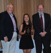 Luana Lima is presented with the Grade 10 Overall Academic Achiever Award by Richard Phelps, chairman of the Rockland School Committee and John Retchless, superintendent of schools.